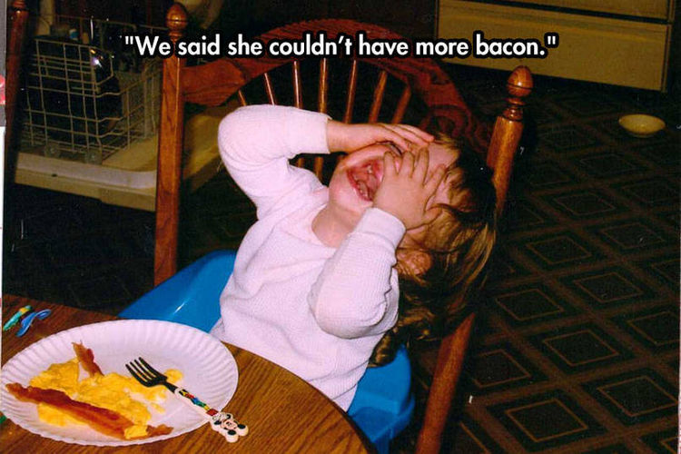 37 Photos of Kids Losing It - We said she couldn't have more bacon.