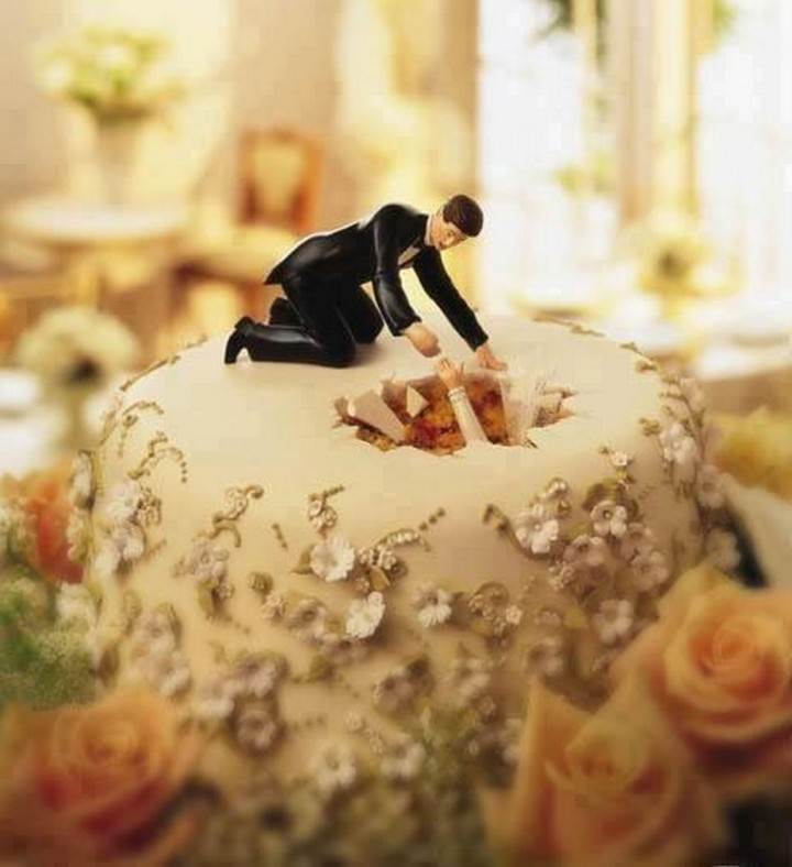 18 Funny Wedding Cake Toppers - The bride literally falling for her groom.
