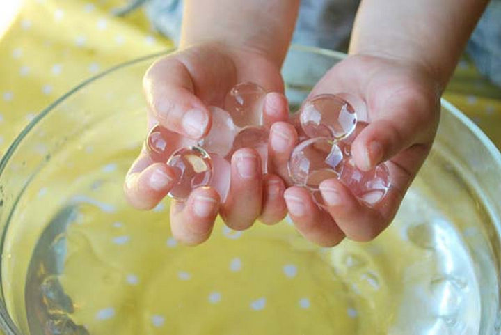 36 Summer Activities for Kids That Cost Less Than $10 - Keep them mesmerized with water marbles.