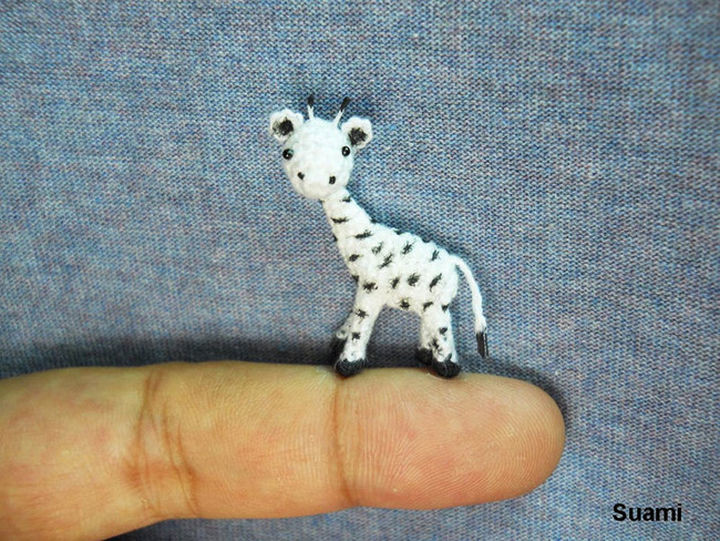 Adorable crochet white giraffe.