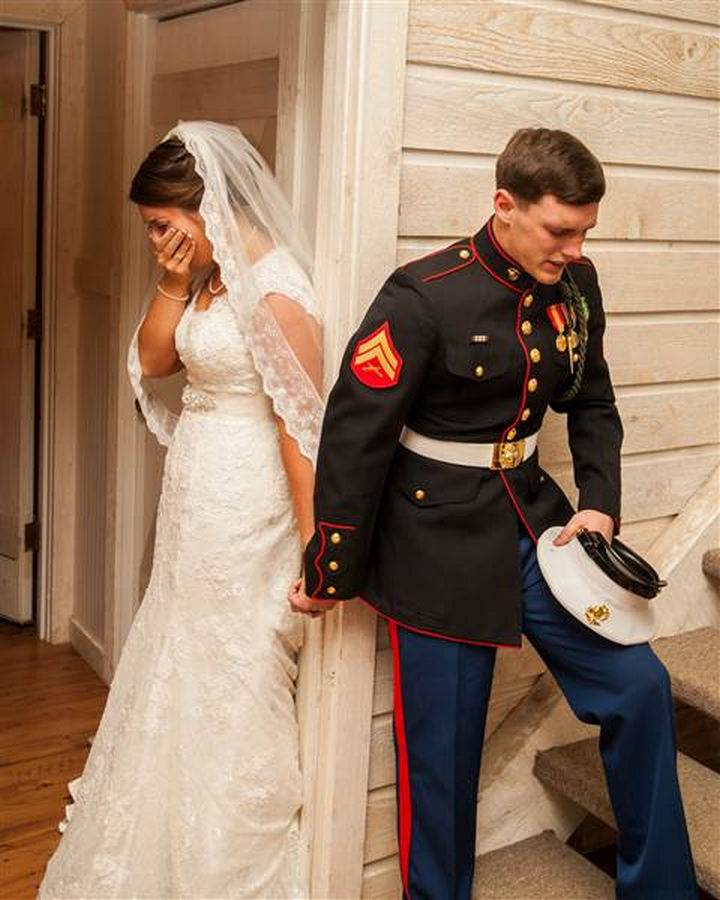 U.S. Marine Corps Cpl. Caleb Earwood and his now-wife Maggie Earwood held hands in prayer and kept their eyes closed as to not see each other before the wedding.