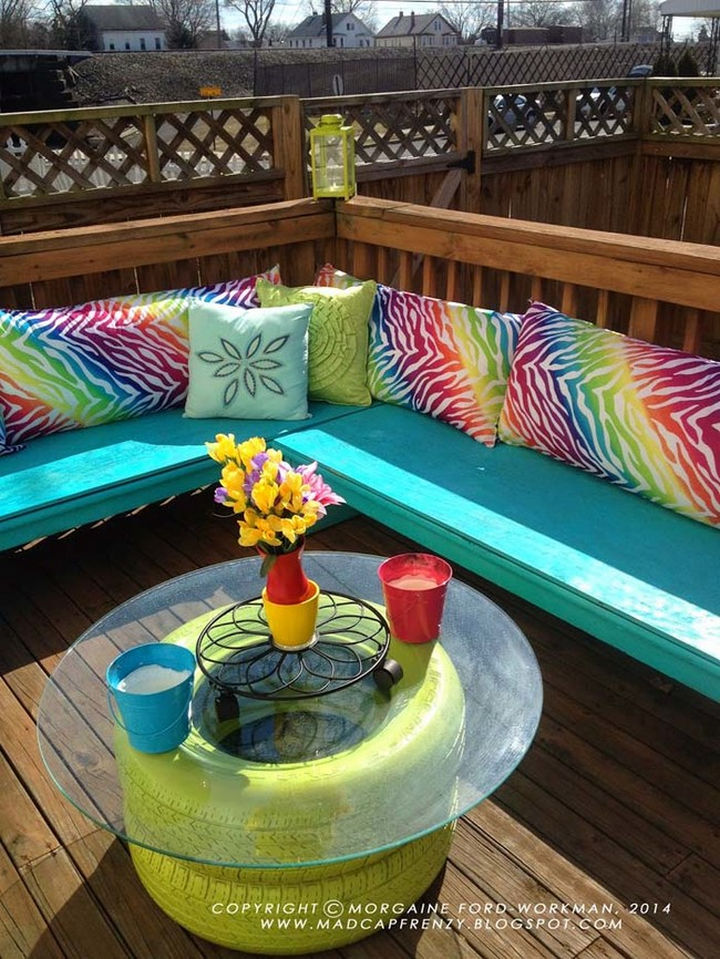22 Awesome Ways to Turn Used Tires Into Something Great - A colorful deck seating area with matching tire coffee table.