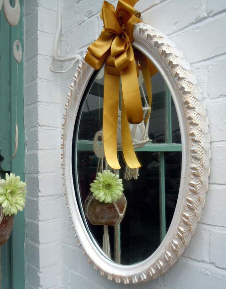 22 Awesome Ways to Turn Used Tires Into Something Great - Create a lovely mirror frame with a bicycle tire.