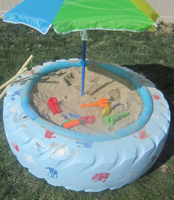 22 Awesome Ways to Turn Used Tires Into Something Great - A colorful sandbox made from a tractor tire.