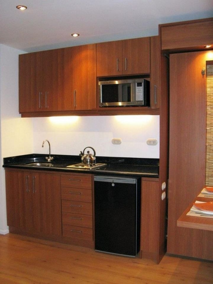 The kitchen looks great and offers a refrigerator, a two-burner stove, and space for a microwave or toaster oven.