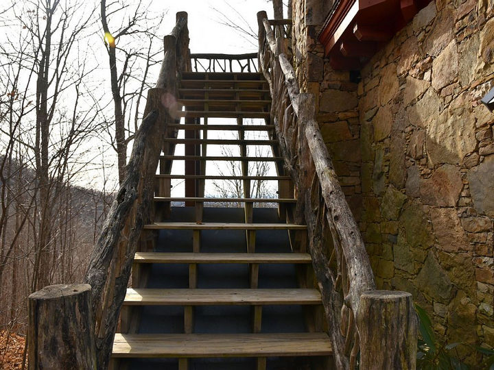 It looks like a castle but also has cabin-like features such as these wooden stairs.