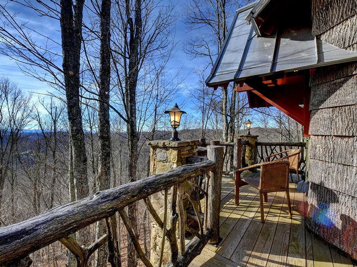 A beautiful rustic deck overlooks the beauty of the Blue Ridge Mountains.