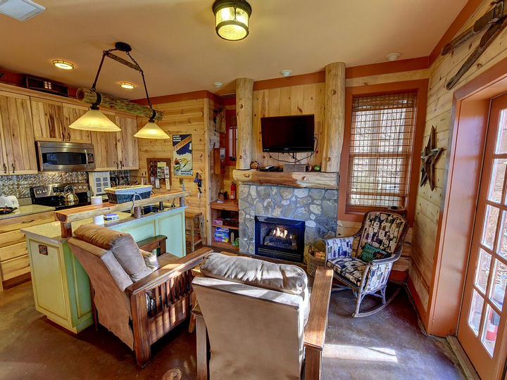 As you make your way down the hobbit hole, you'll encounter a cozy kitchen and living room area.