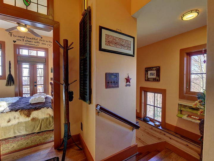 As you make your way up to the third floor, you'll find 2 bedrooms that are as unique as this cabin.