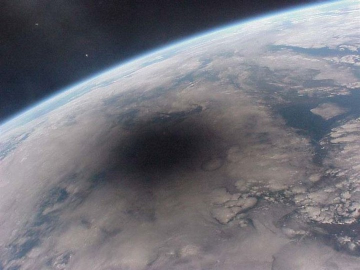 21 Awe-Inspiring Photos - An eclipse as seen from space.