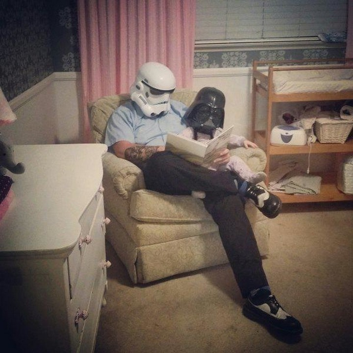 21 Hilarious Parents - Father and son Star Wars fans being swept in a book to a galaxy far, far away.