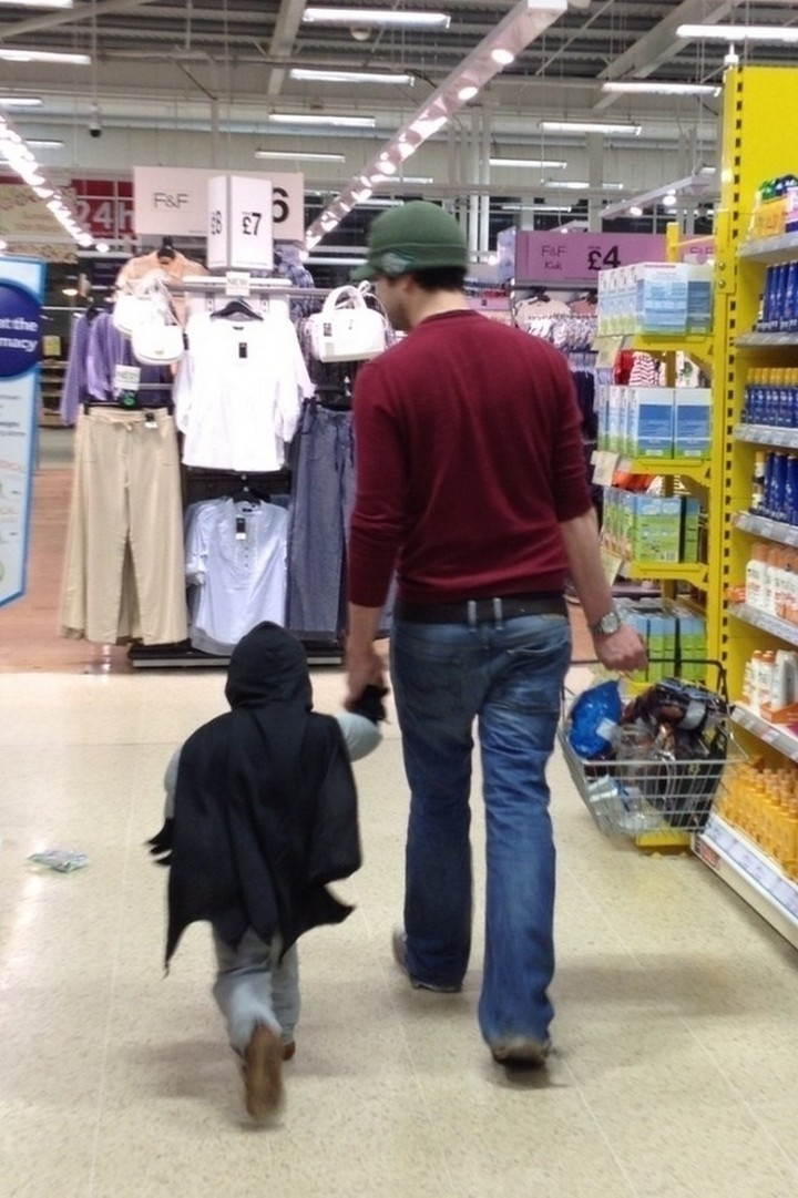 21 Hilarious Parents - Father shopping with his favorite little superhero.
