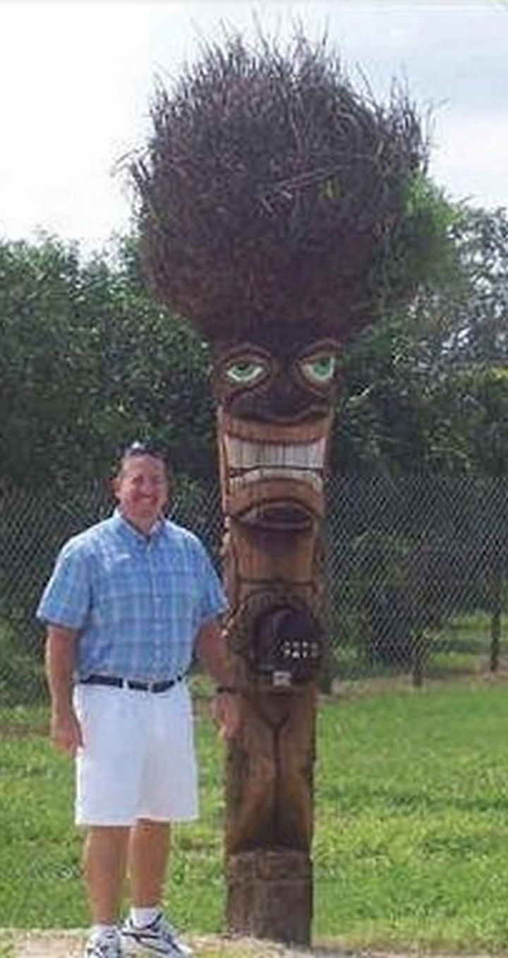 28 Unique Mailboxes That Are So Funny - A tiki torch that loves getting mail.