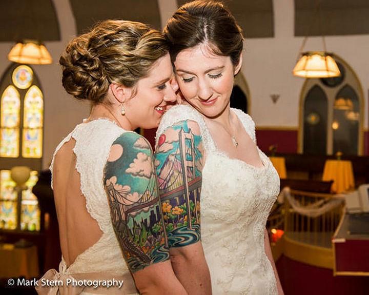 35 couple tattoos - A bridge built with love couple tattoos.