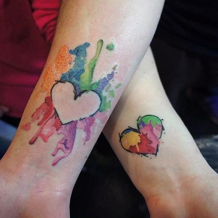 35 couple tattoos - Inverted hearts couple tattoos.
