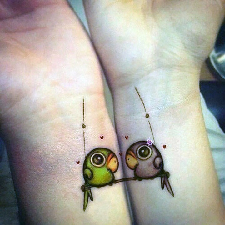 35 couple tattoos - Love birds couple tattoos.