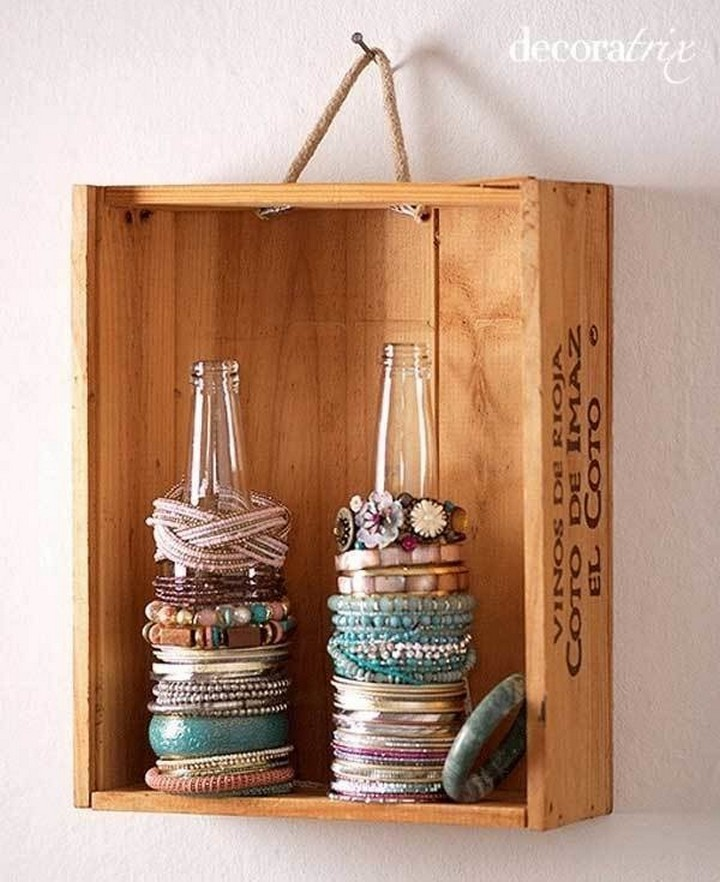 46 Useful Storage Ideas - Use empty glass bottles as bracelet holders.