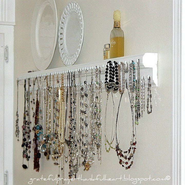 46 Useful Storage Ideas - Create a jewelry organizer shelf using tacks and a few pieces of wood trim.
