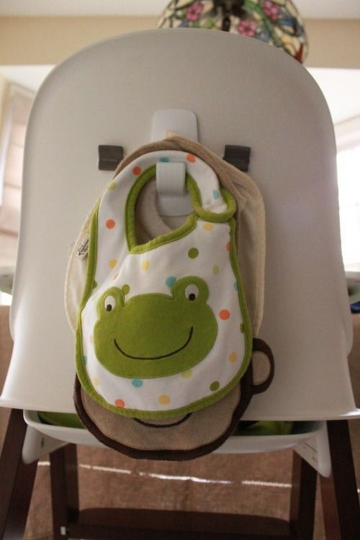 46 Useful Storage Ideas - Install an adhesive hook behind your baby's high chair to hang baby bibs or other baby supplies.
