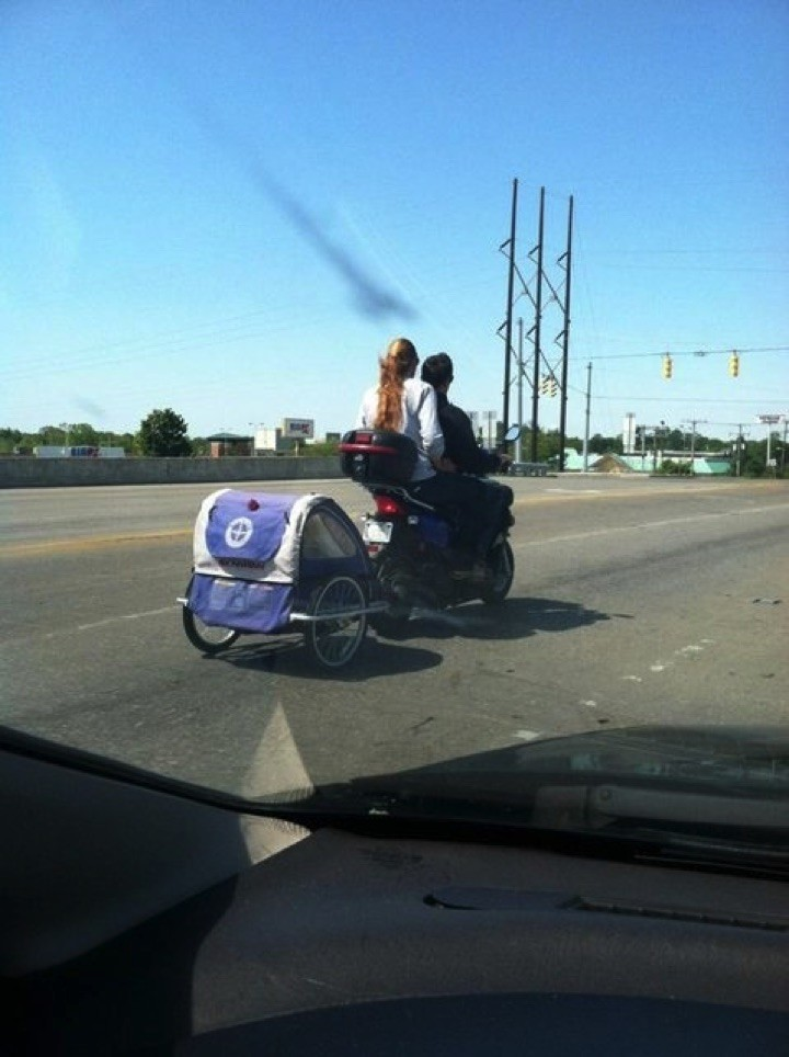 34 Parenting Fails - I think baby bicycle strollers were designed for sidewalks, not highways!!