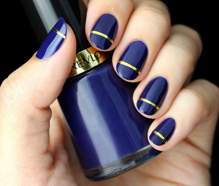18 Striped DIY Nail Designs - Glossy indigo blue with a gold stripe is pure  elegance - 18 Nail Tape Striped DIY Nail Designs That Are Easy To Create