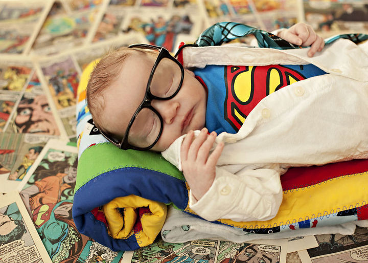 37 Newborns Wearing Geek Baby Clothes - Baby Clark Kent.