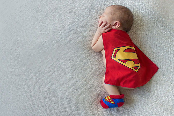 37 Newborns Wearing Geek Baby Clothes - Baby Superman.
