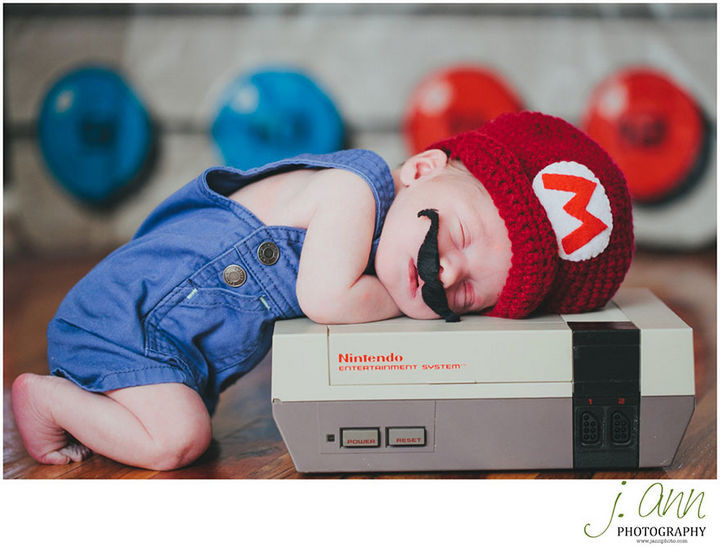 "37 Newborns Wearing Geek Baby Clothes - ""It's a me, baby Mario!"""