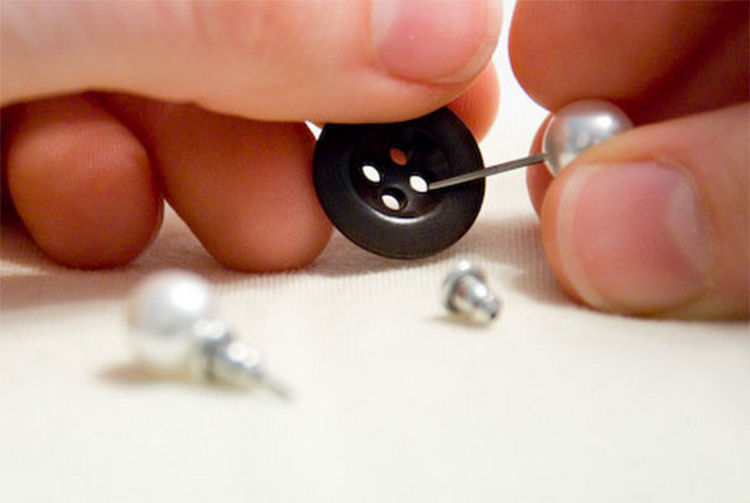 47 Amazing Life Hacks - Button - Never lose a matching earring again by storing them together using a normal button.