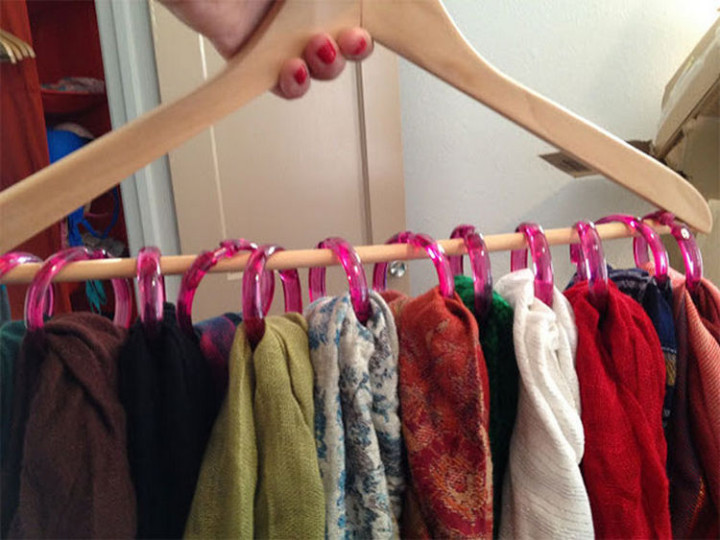 47 Amazing Life Hacks - Curtain Rings - Use old shower curtain rings and a clothes hanger to create a handy scarf holder.