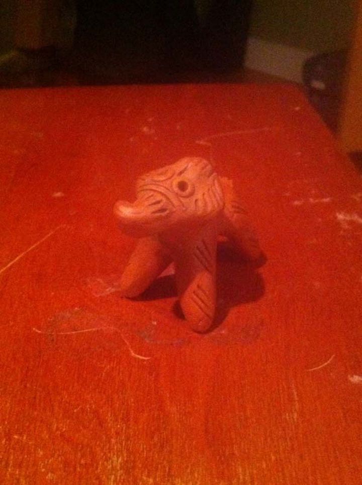 A strange carved wooden elephant was found underneath the white blanket.