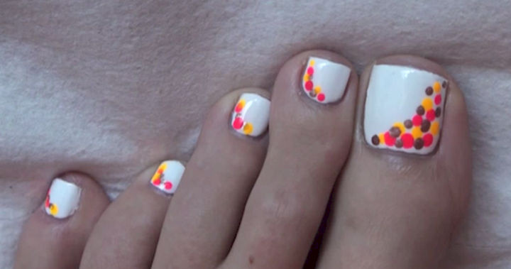 13 Pedicure Designs - Express yourself with colorful polka dots.