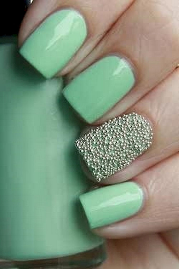 18 Green Manicures - Pretty solid green mani with a caviar accent nail.