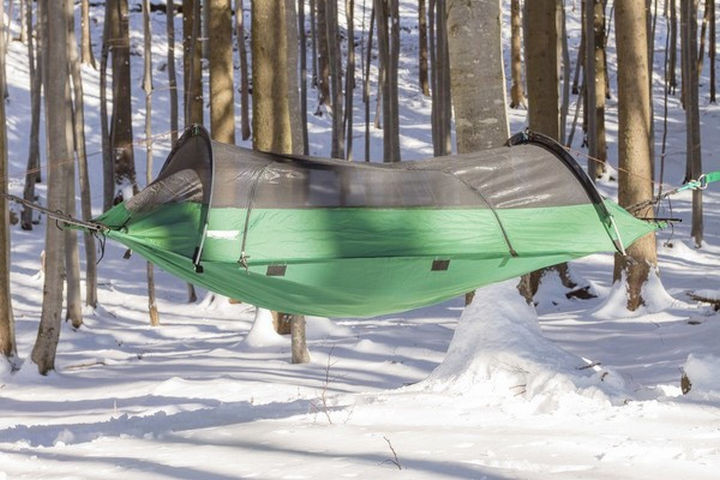 Meet the Blue Ridge Camping Hammock. It's a tent that doubles as a hammock so you can set it up anywhere during any season.