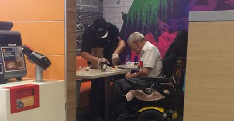 McDonald's Employee Helps Disabled Elderly Man Eat his Meal.