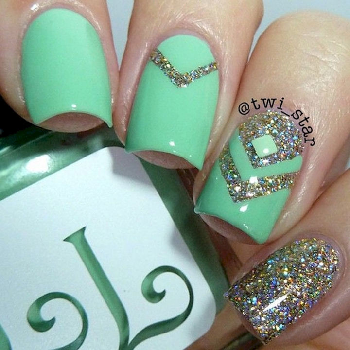 18 Beautiful Green Nails for Fall - A pastel lime green manicure with subtle chevron patterns.