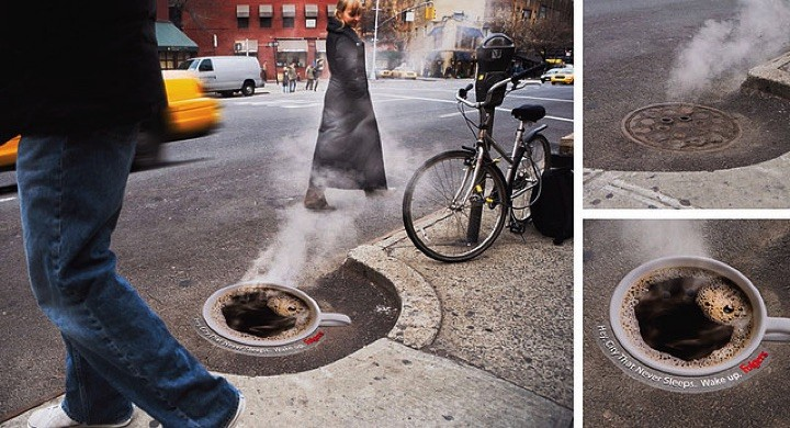21 Creative Billboard Ads - A coffee ad over a manhole cover demonstrating a steaming hot cup of coffee.