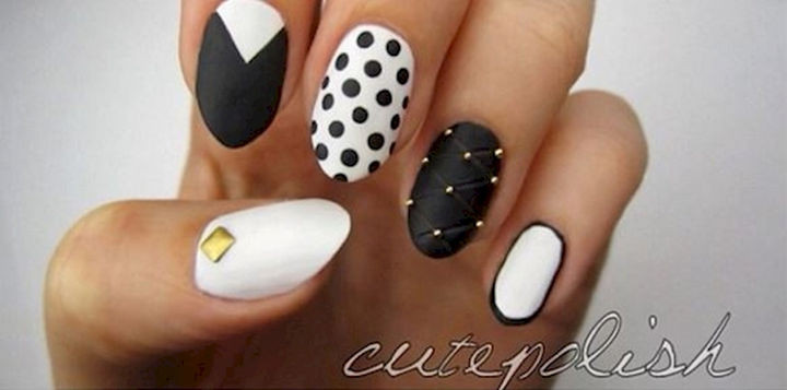 22 Black Nails That Look Edgy and Chic - A trendy studded manicure.