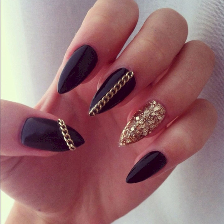 22 Black Nails That Look Edgy and Chic - Bring on the gold chains with these gloss black stiletto nails.