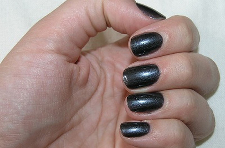 22 Black Nails That Look Edgy and Chic - Get a futuristic style with shimmering nails.