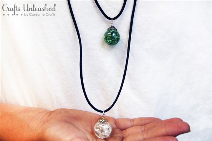 This lovely necklace features a unique gem...a cracked glass marble! Looks awesome!