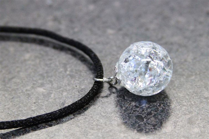 Once dry, you can insert a jump ring into the eye pin and loop it through your necklace.