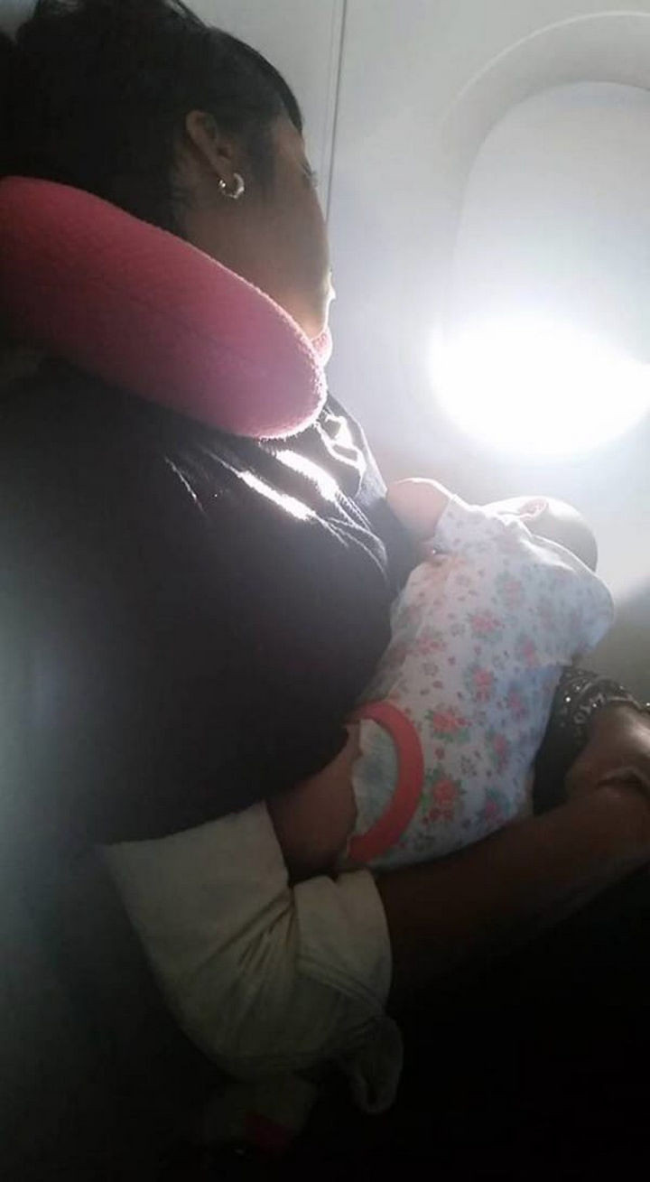 Even after they moved seats, her baby wouldn't stop crying. A woman sitting next to her, Nyfesha, asked if she could hold her crying baby. Within minutes, the baby stopped crying and began looking out the plane window.