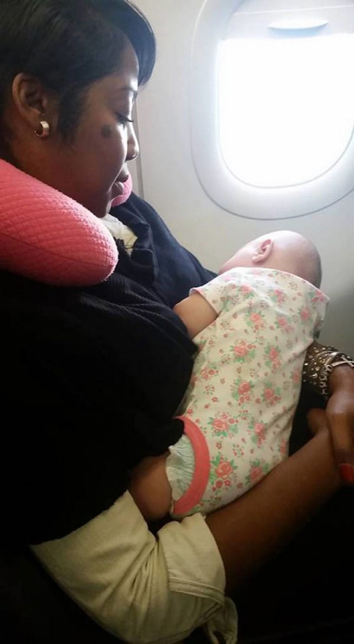 Nyfesha cared for the baby for the rest of flight and Rylee slept quietly the rest of the way. When they got off the plane, Nyfesha continued holding the baby whileRebekka put the stroller and car seat together.