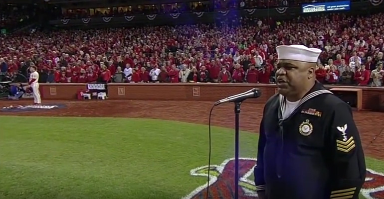 Retired Navy Officer Generald Wilson sings 'God Bless America' .