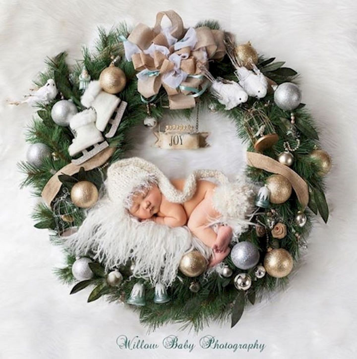13 Cute Babies Wearing Christmas Outfits - A joyous wreath.