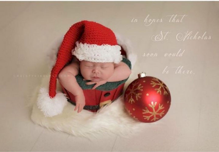 13 Cute Babies Wearing Christmas Outfits - Waiting for a glimpse of Santa.