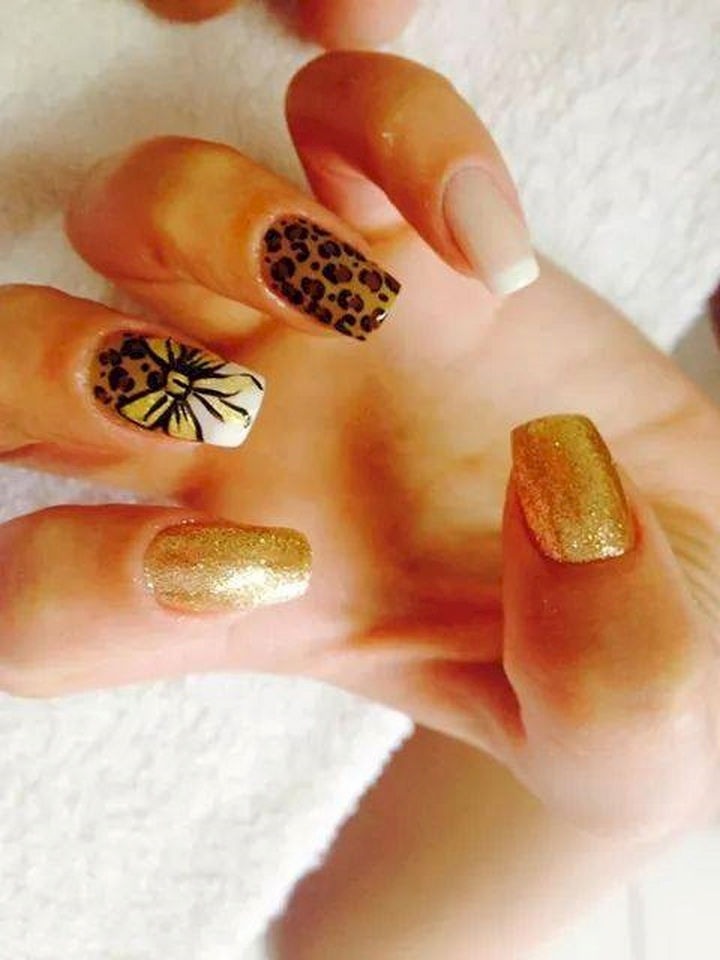 18 Perfectly Manicured Bow Nails - Leopard print nails with a matching bow.