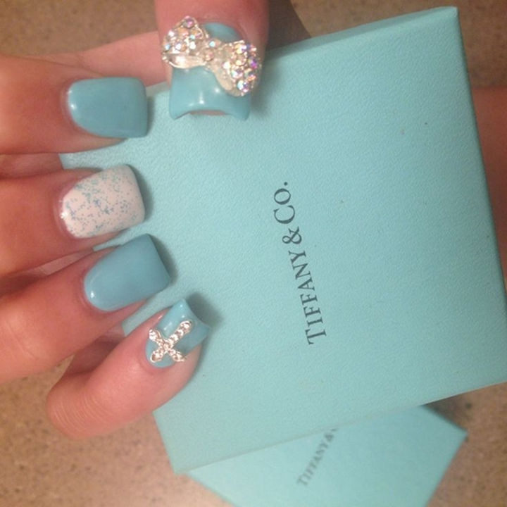18 Perfectly Manicured Bow Nails - Tiffany blue nails with colorful accent bow.