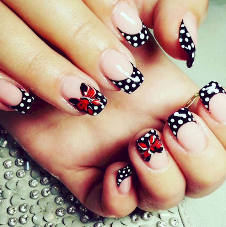 18 Perfectly Manicured Bow Nails - What could be cuter than polka dots and bows?